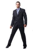 Uomo d'affari che si leva in piedi sopra il bianco. Fotografia Stock Libera da Diritti