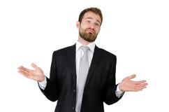 Uomo d'affari che si libera contro il fondo bianco Immagine Stock