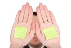 Uomo d'affari che si nasconde dietro le mani Fotografie Stock