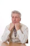 Uomo d'affari che si siede un bianco Immagini Stock Libere da Diritti