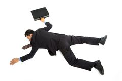 Uomo d'affari che si trova giù Fotografia Stock Libera da Diritti
