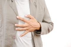 Uomo d'affari che soffre dall'attacco di cuore. Immagine Stock