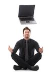 Uomo d'affari che sogna di un computer portatile Fotografia Stock