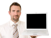 Uomo d'affari che sostiene computer portatile con il percorso di residuo della potatura meccanica immagini stock libere da diritti