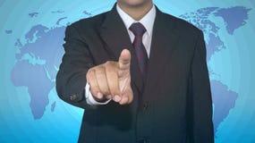 Uomo d'affari che spinge l'icona del bottone con valuta del dollaro Fotografia Stock Libera da Diritti