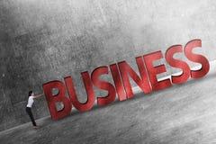 Uomo d'affari che spinge parola di affari 3D in salita Immagini Stock Libere da Diritti
