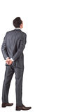 Uomo d'affari che sta con le mani dietro indietro fotografie stock