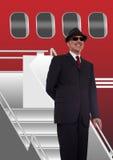 Uomo d'affari che sta sulle scale all'aeroplano immagini stock