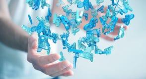 Uomo d'affari che tiene 3D che rende gruppo di gente blu Fotografie Stock