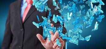 Uomo d'affari che tiene 3D che rende gruppo di gente blu Fotografie Stock Libere da Diritti