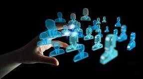 Uomo d'affari che tiene 3D che rende gruppo di gente blu Immagini Stock