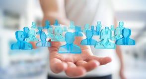 Uomo d'affari che tiene 3D che rende gruppo di gente blu Immagine Stock