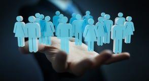 Uomo d'affari che tiene 3D che rende gruppo di persone in sua mano Immagine Stock
