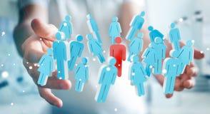 Uomo d'affari che tiene 3D che rende gruppo di persone in sua mano Immagini Stock Libere da Diritti