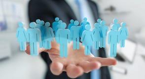 Uomo d'affari che tiene 3D che rende gruppo di persone in sua mano Immagini Stock