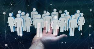 Uomo d'affari che tiene 3D che rende gruppo di persone in sua mano Fotografia Stock