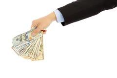 Uomo d'affari che tiene dollaro americano Isolato su una priorità bassa bianca Immagine Stock
