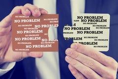 Uomo d'affari che tiene due pezzi di puzzle Fotografia Stock Libera da Diritti