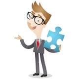 Uomo d'affari che tiene il pezzo blu del puzzle illustrazione di stock