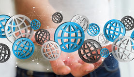 Uomo d'affari che tiene il rendering' digitale delle icone '3D di web Fotografia Stock