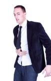 Uomo d'affari che tiene il suo stomaco Immagini Stock