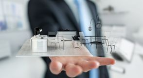 Uomo d'affari che tiene l'appartamento bianco della rappresentazione 3D Immagine Stock Libera da Diritti