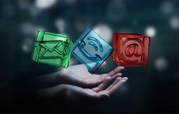 Uomo d'affari che tiene l'icona trasparente del contatto del cubo in sua mano 3D Fotografia Stock