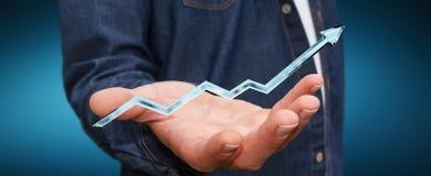 Uomo d'affari che tiene la rappresentazione blu digitale della freccia 3D Immagine Stock Libera da Diritti