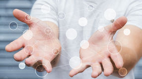 Uomo d'affari che tiene la rete di trasmissione di dati digitale nel suo renderin della mano 3D Fotografia Stock Libera da Diritti