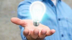 Uomo d'affari che tiene lampadina brillante nella sua rappresentazione della mano '3D Fotografia Stock Libera da Diritti