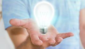 Uomo d'affari che tiene lampadina brillante nella sua rappresentazione della mano '3D Fotografie Stock Libere da Diritti