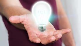 Uomo d'affari che tiene lampadina brillante nella sua rappresentazione della mano '3D Immagine Stock