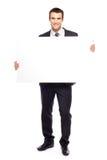 Uomo d'affari che tiene manifesto in bianco fotografia stock