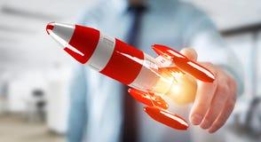 Uomo d'affari che tiene razzo rosso nella sua rappresentazione della mano 3D Fotografie Stock Libere da Diritti