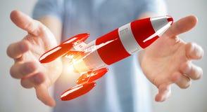 Uomo d'affari che tiene razzo rosso nella sua rappresentazione della mano 3D Immagine Stock