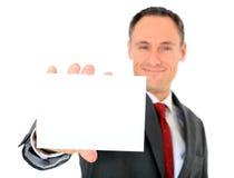 Uomo d'affari che tiene scheda bianca in bianco Fotografie Stock Libere da Diritti