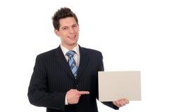 Uomo d'affari che tiene segno in bianco fotografia stock libera da diritti