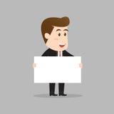 Uomo d'affari che tiene segno in bianco Fotografia Stock
