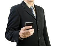 Uomo d'affari che tiene telefono mobile Fotografia Stock