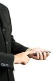 Uomo d'affari che tiene telefono mobile Fotografie Stock Libere da Diritti