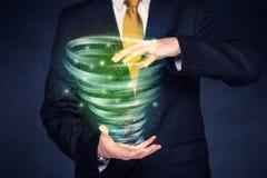 Uomo d'affari che tiene tornado verde immagini stock libere da diritti