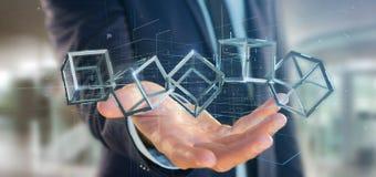 Uomo d'affari che tiene un cubo del blockchain della rappresentazione 3d sulla a Immagine Stock