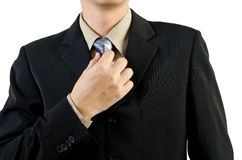 Uomo d'affari che tiene un legame Fotografie Stock