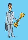 Uomo d'affari che tiene la chiave al successo Fotografie Stock Libere da Diritti