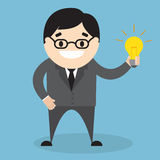 Uomo d'affari che tiene una lampada Fotografia Stock Libera da Diritti