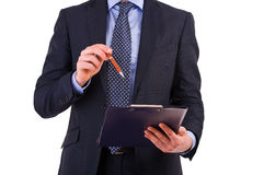 Uomo d'affari che tiene una lavagna per appunti. Immagini Stock Libere da Diritti