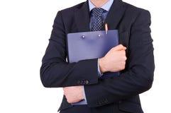 Uomo d'affari che tiene una lavagna per appunti. Fotografia Stock Libera da Diritti