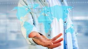 Uomo d'affari che tiene una mappa di mondo collegata su un interf futuristico Immagine Stock