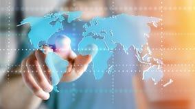 Uomo d'affari che tiene una mappa di mondo collegata su un interf futuristico Fotografia Stock