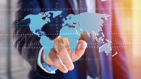 Uomo d'affari che tiene una mappa di mondo collegata su un interf futuristico Immagine Stock Libera da Diritti